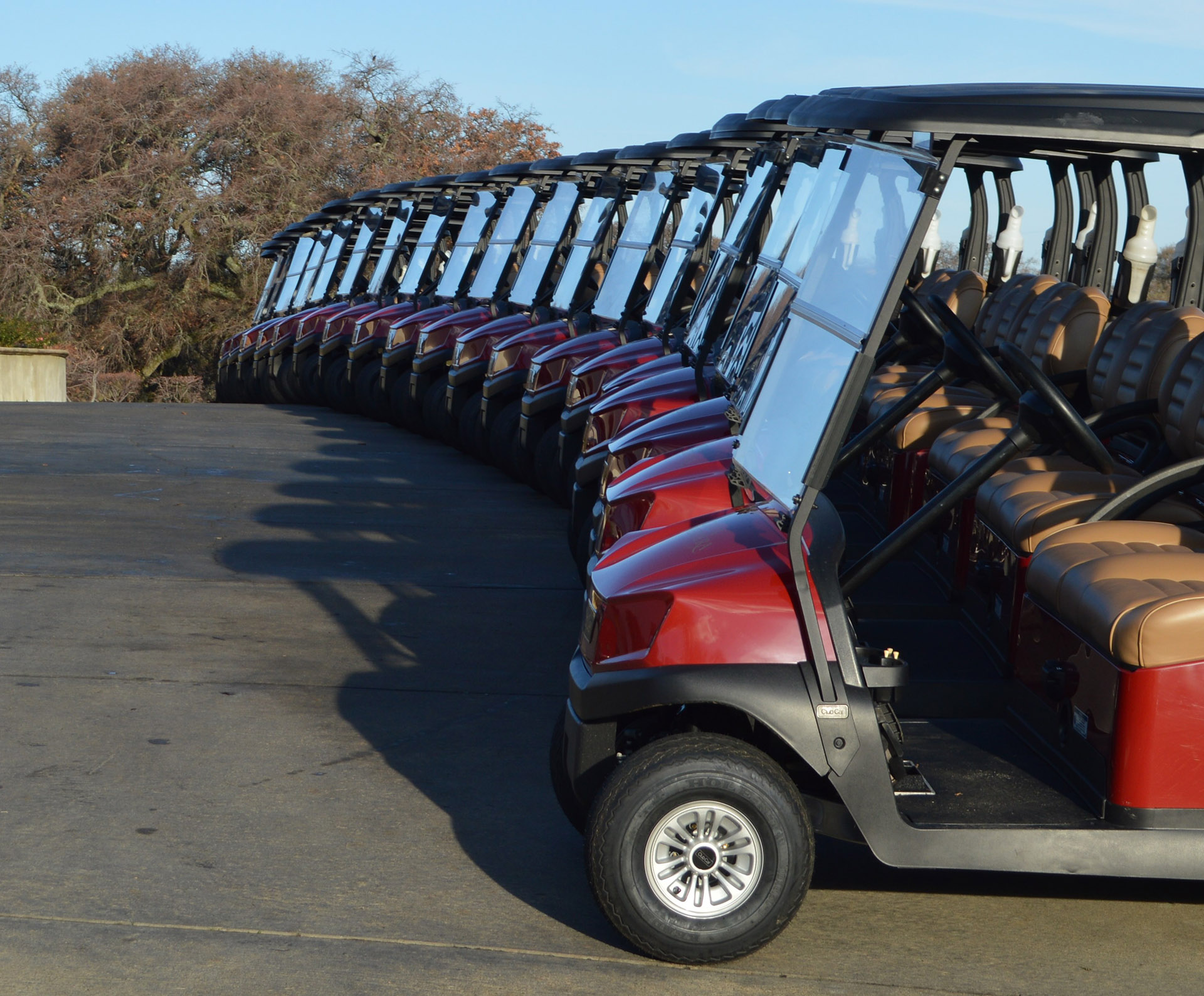 A golf cart sits next to the path at Catta Verdera Country Club at Twelve Bridges